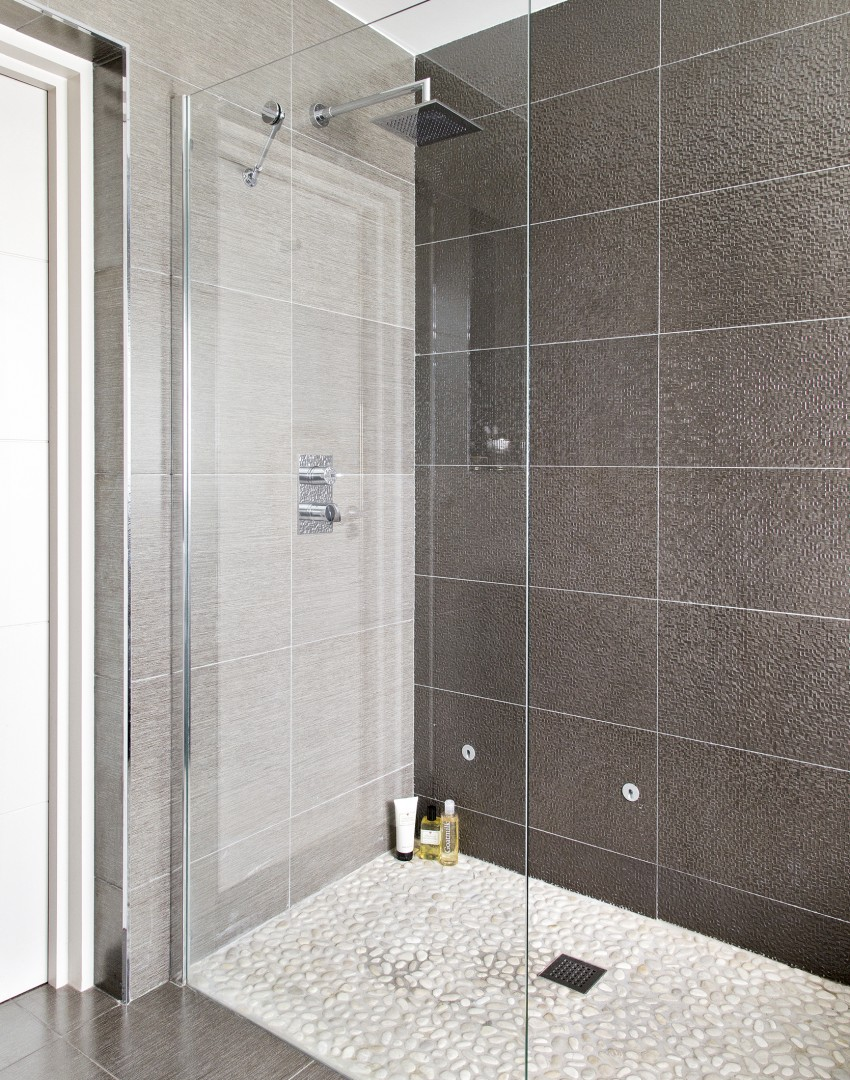 Turn a simple shower into an energising spa space the for Shower room floor tiles