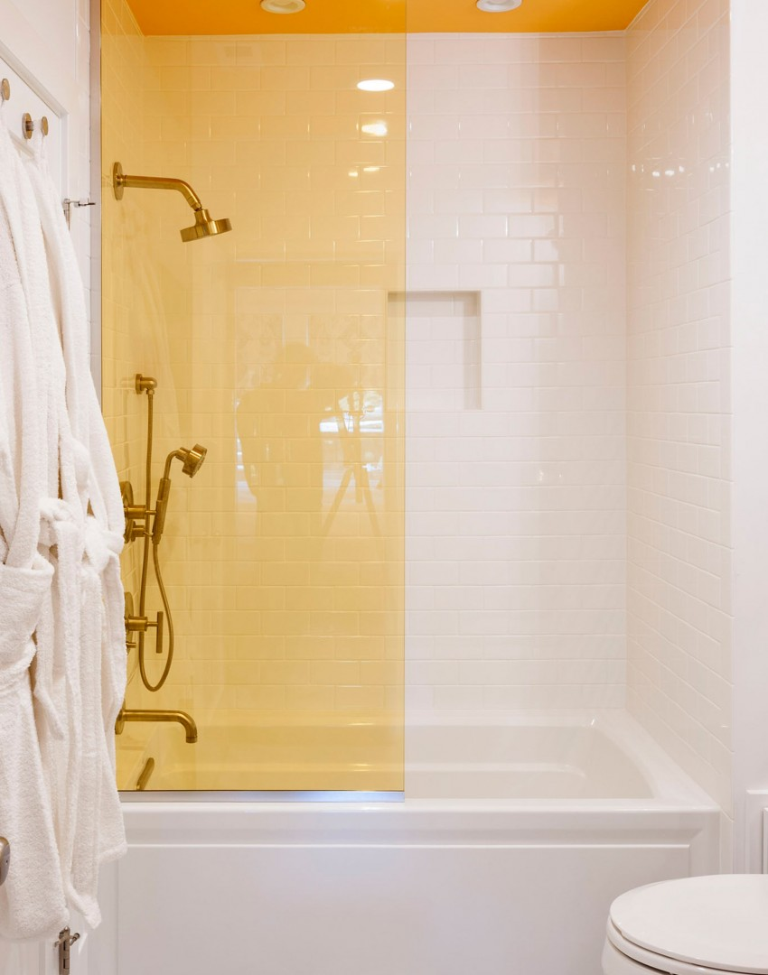 Modern White Bathroom with Yellow Shower Screen and Ceiling