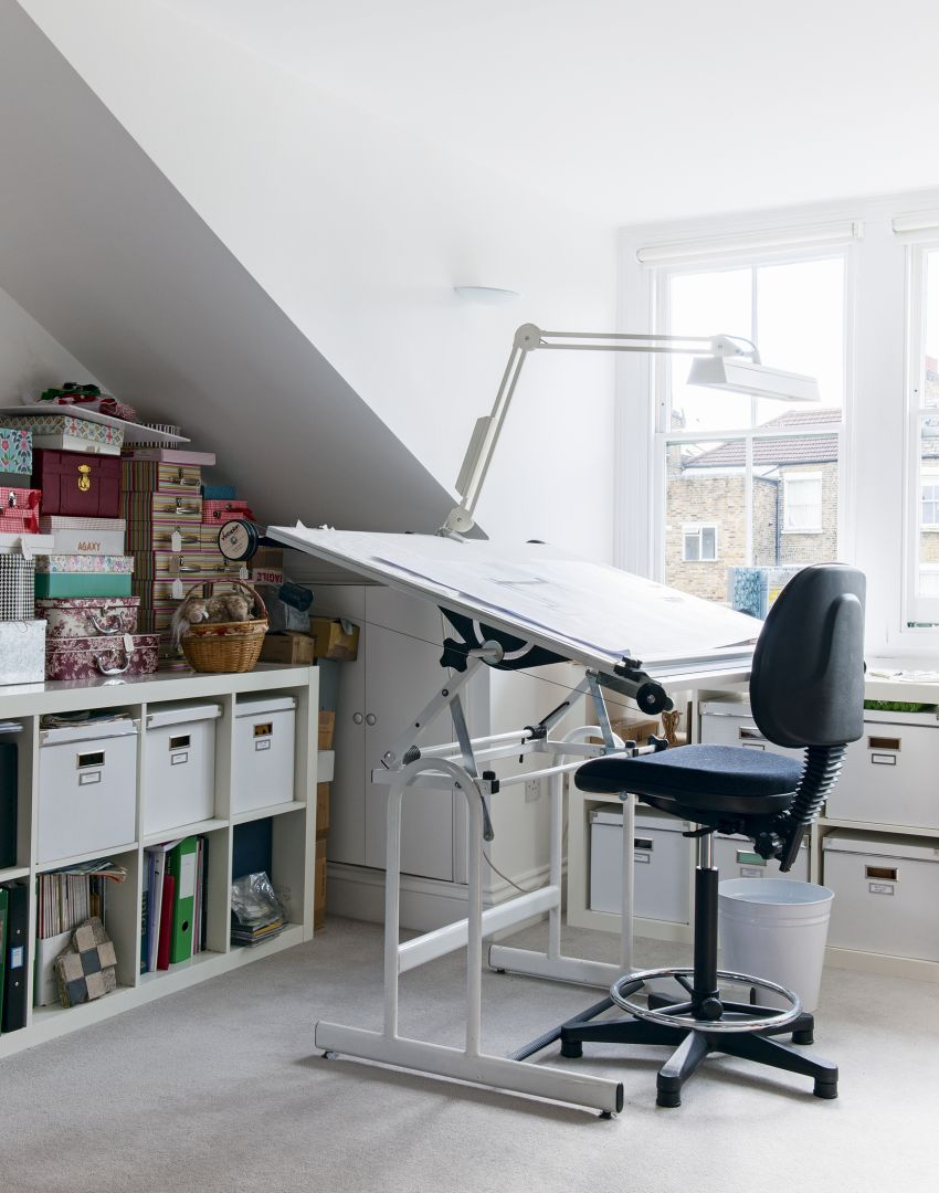 Simple White Home-office Studio with Under-eaves Storage