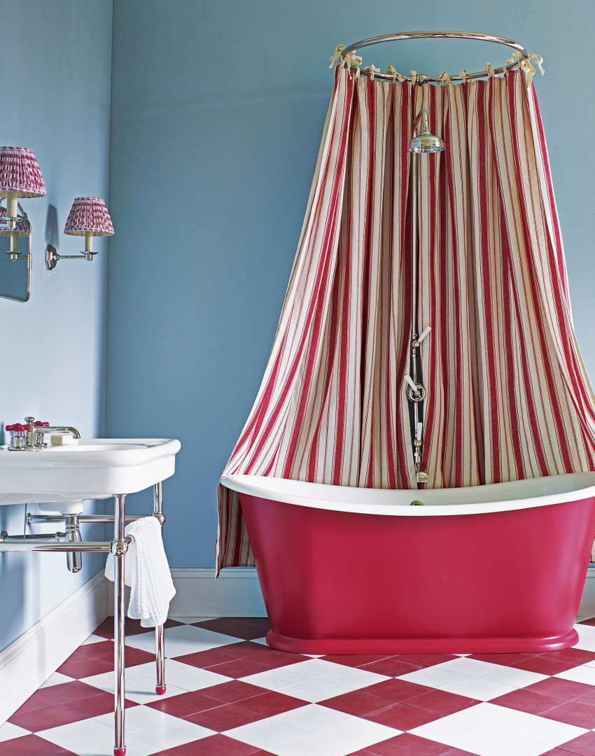 Eye-popping Blue and Red Bathroom with Striped Shower Curtain and Chequerboard Floor