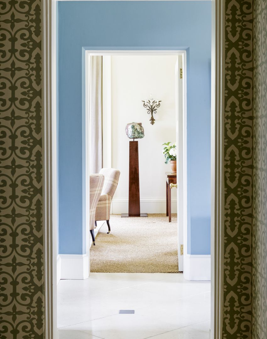 Blue Hallway with Gold Patterned Wallpaper