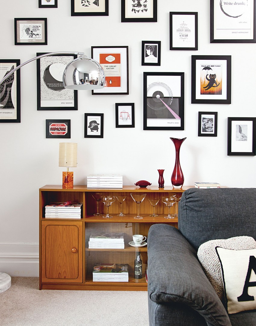 White Modern Living Room with Black-framed Wall Prints