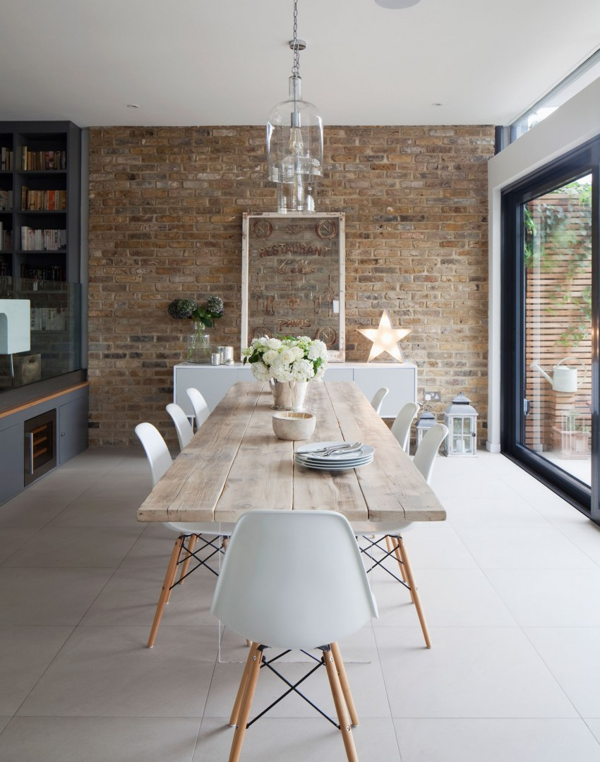 white scandistyle dining room with exposed brick wall