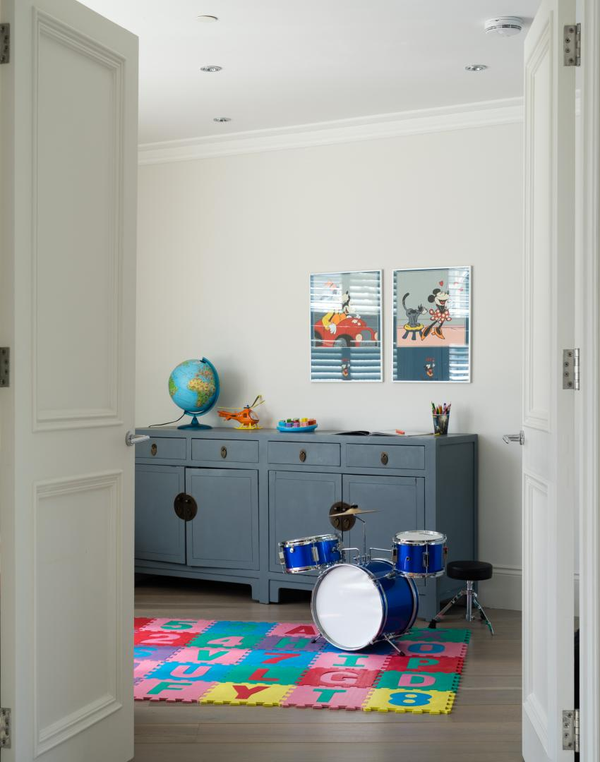 Child's Modern White Room with Drum Kit