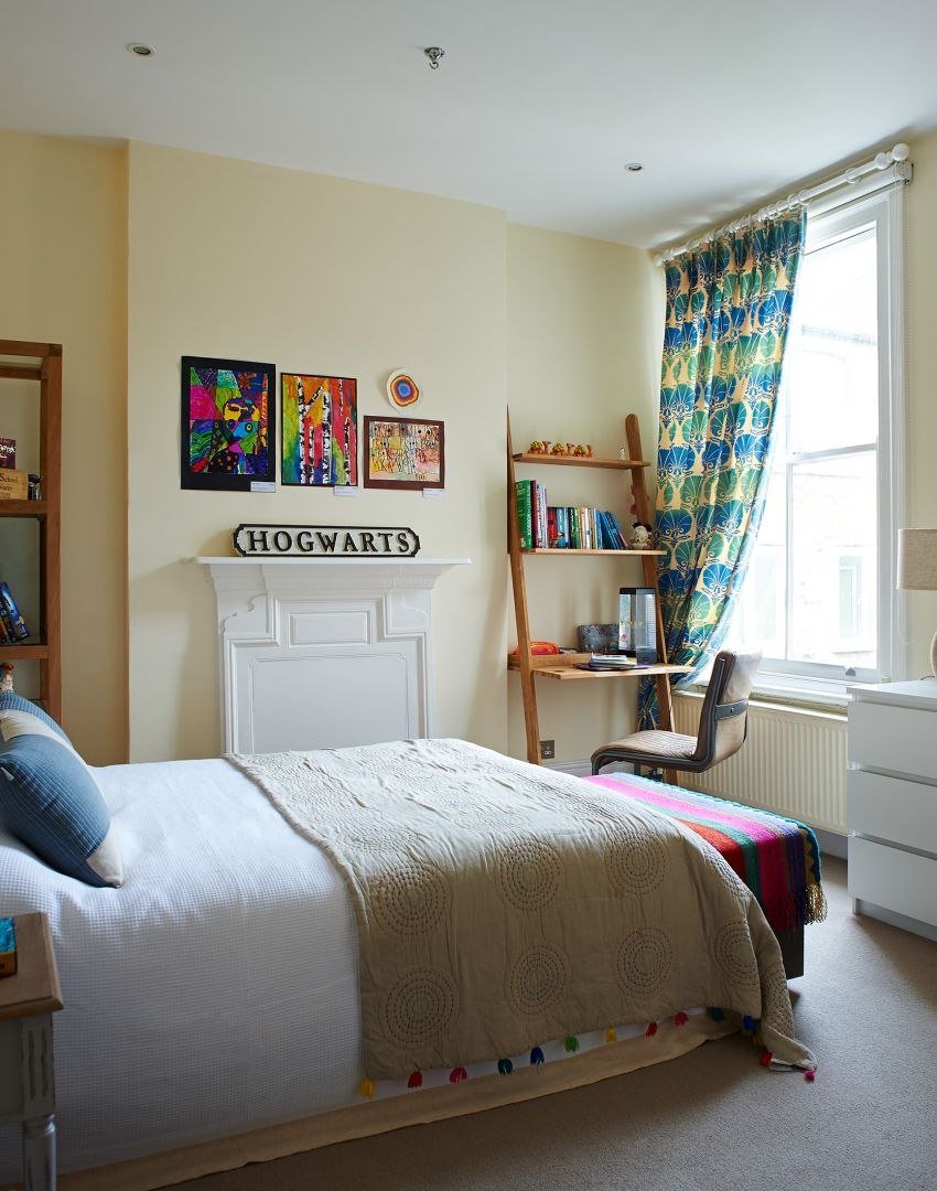 Child's Yellow Traditional Room with Patterned Curtains and Storage Desk