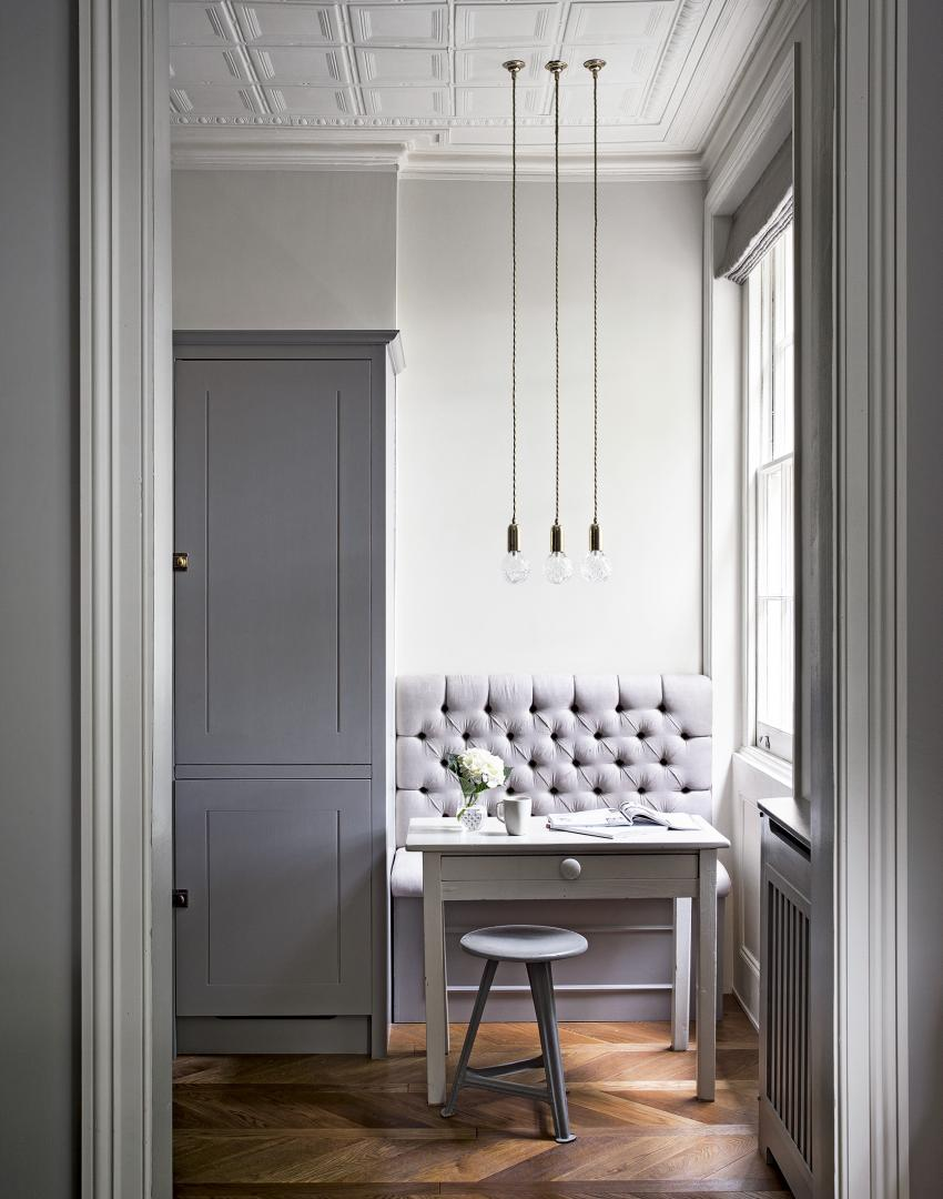 Grey Traditional Dining Room with Banquette Area and Trio of Lights