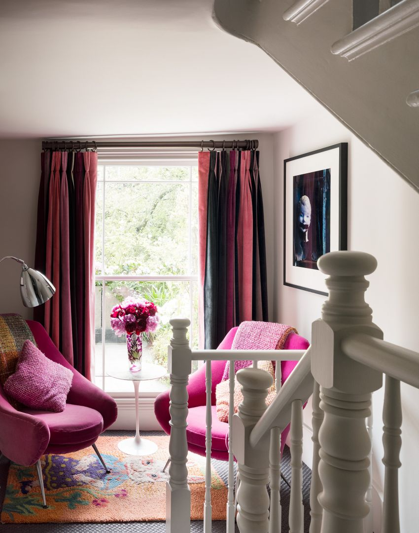 Landing reading nook with pink mid-century chairs
