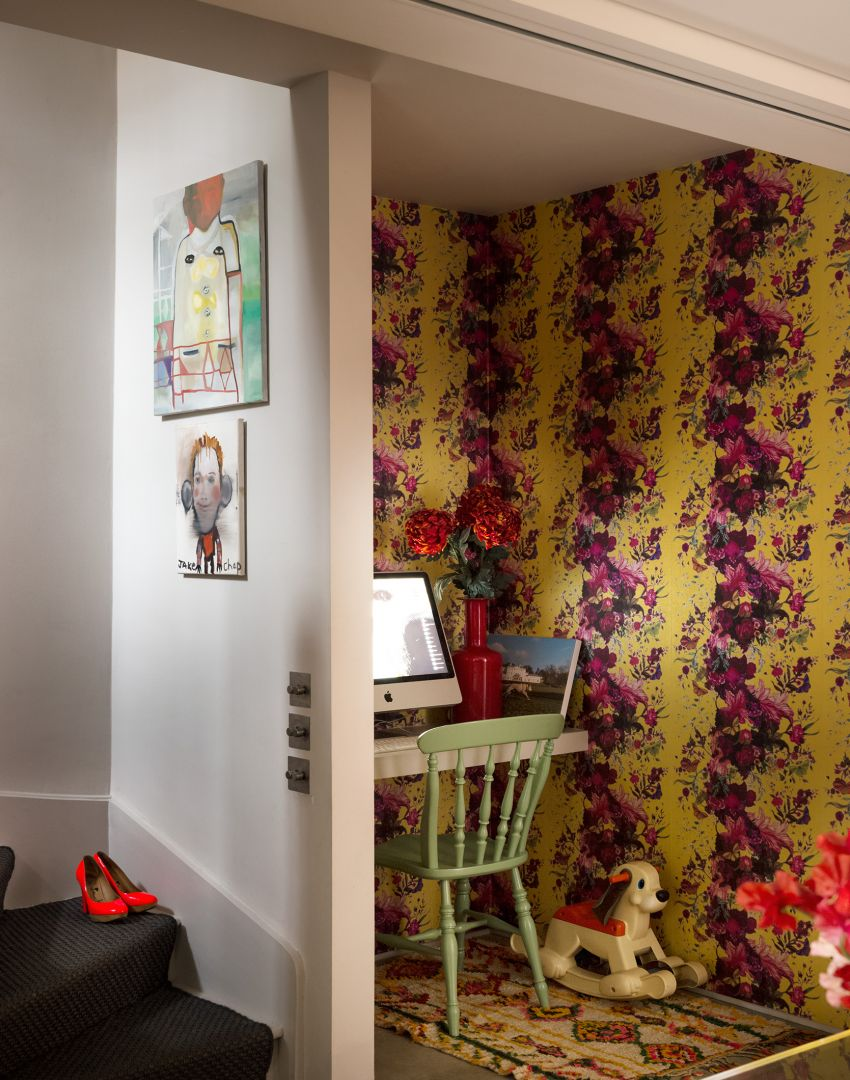 Study nook with yellow and pink floral wallpaper