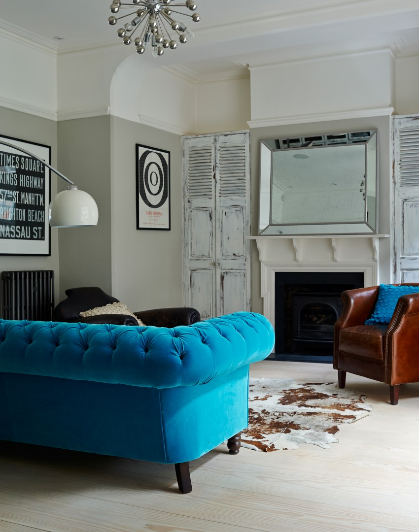 Traditional Living Room With Bright Blue Sofa