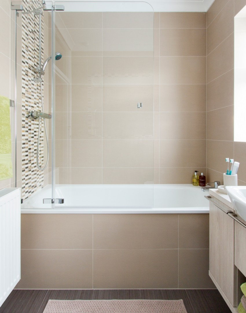 traditional taupe bathroom with over bath shower the