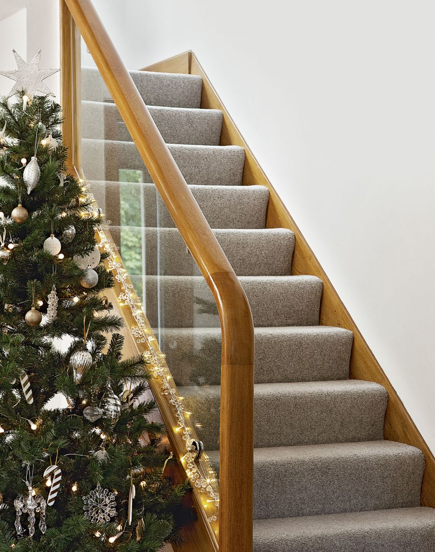 Festive White Hallway with Oak Banister and Glass Panel