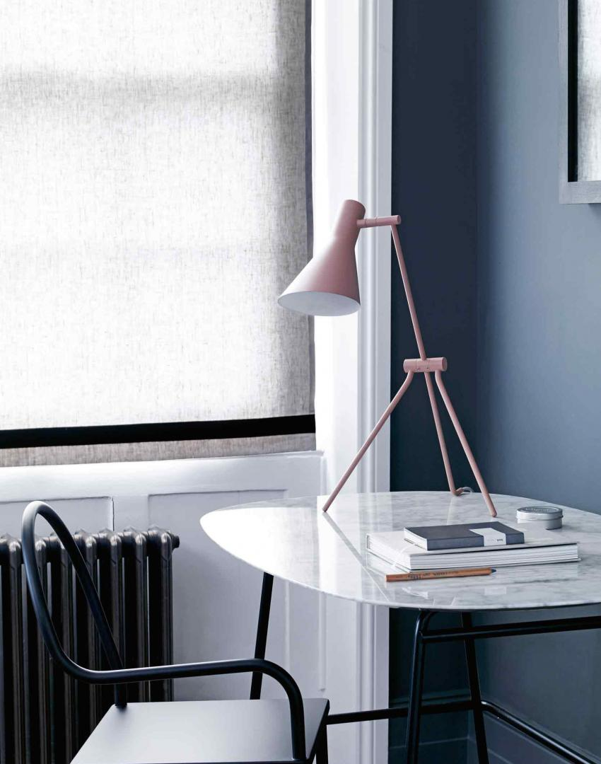 Dark grey home office with contemporary pink table lamp
