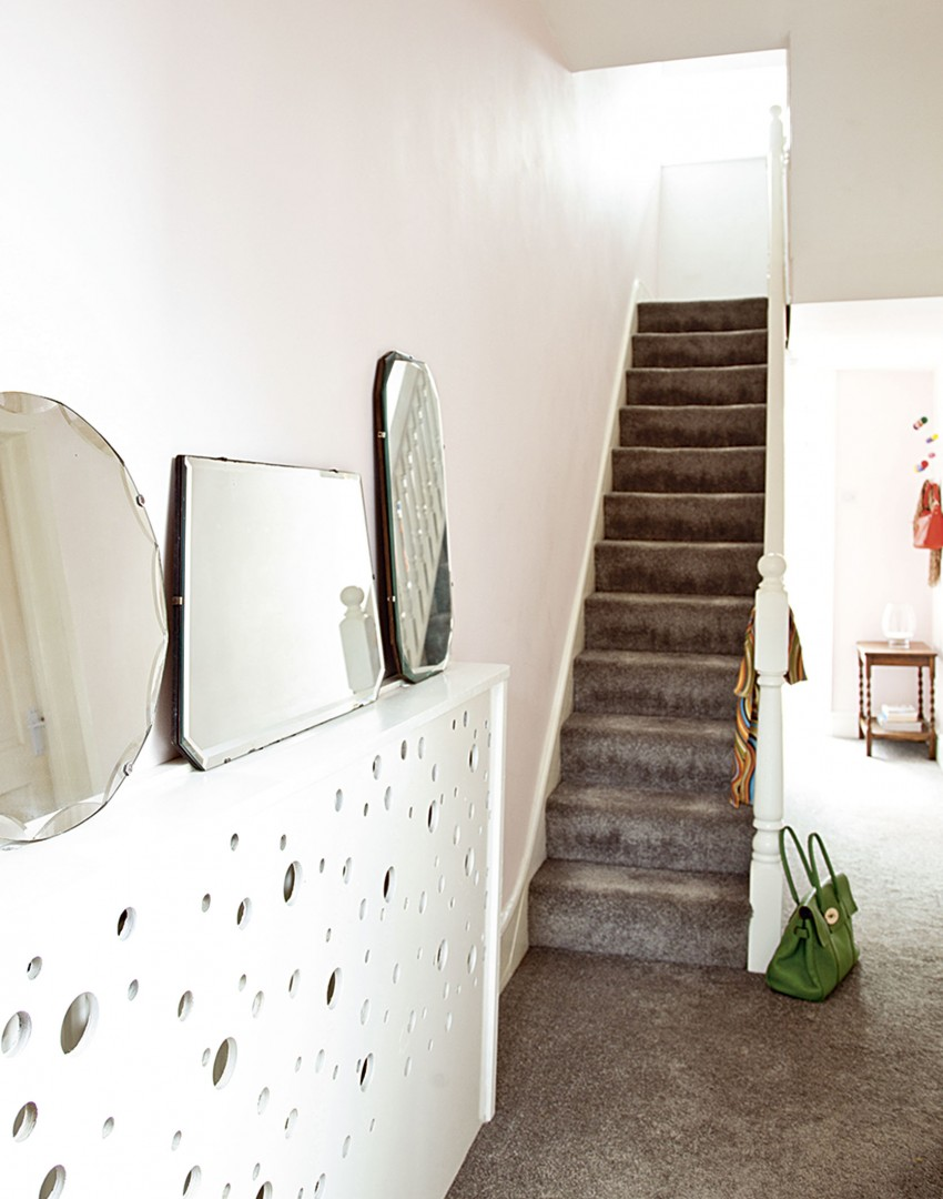 Neutral Hallway with Statement Mirrors