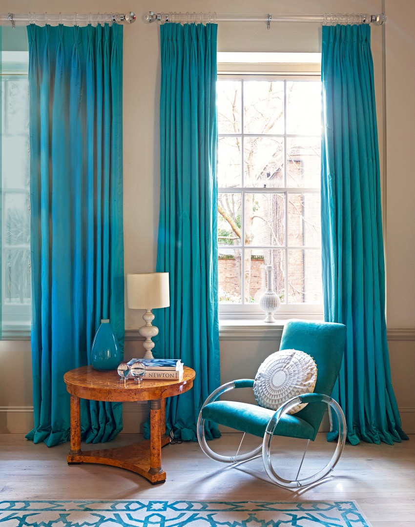 blue living room curtains. Modern White Living Room with Blue Curtains and Chair Bring your to Life a Well Chosen Window Treatment
