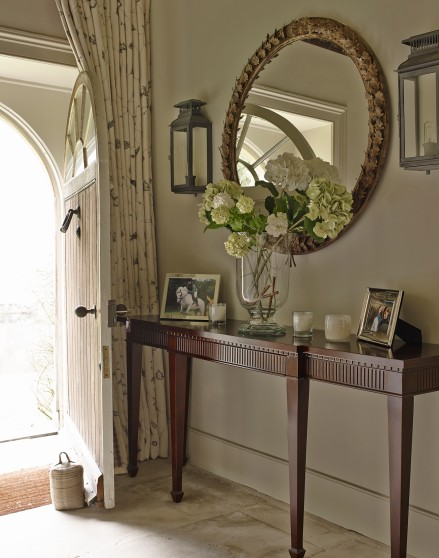 Traditional Hallway With Dark Wood Console Table The