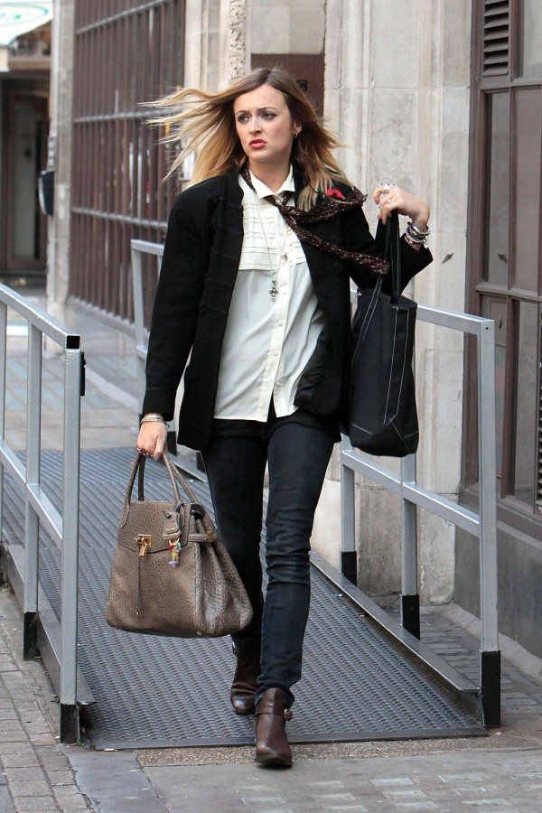 Fearne Cotton walks down the street with two handbags