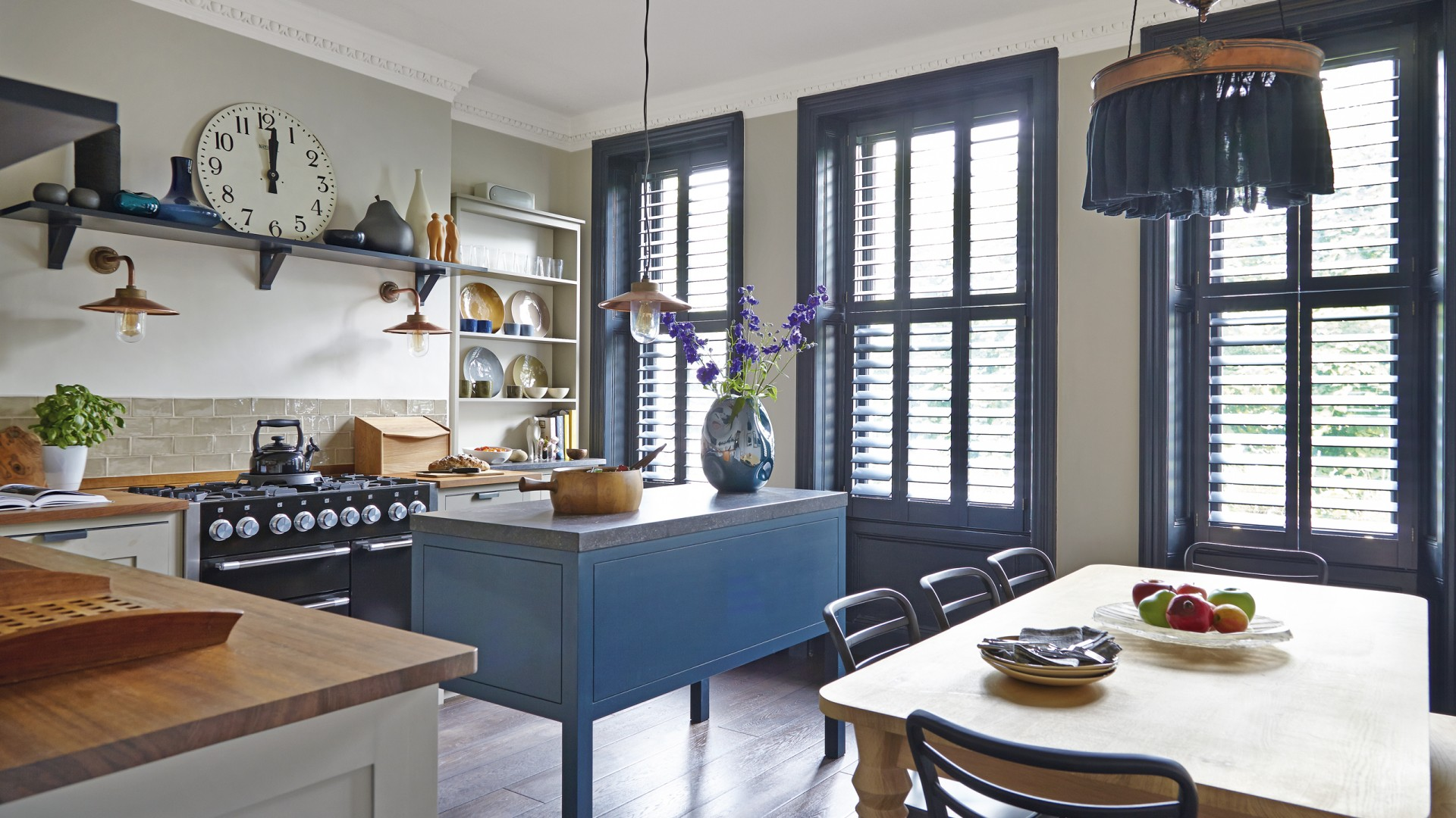 Country Style Kitchen With Blue Island And Window Frames