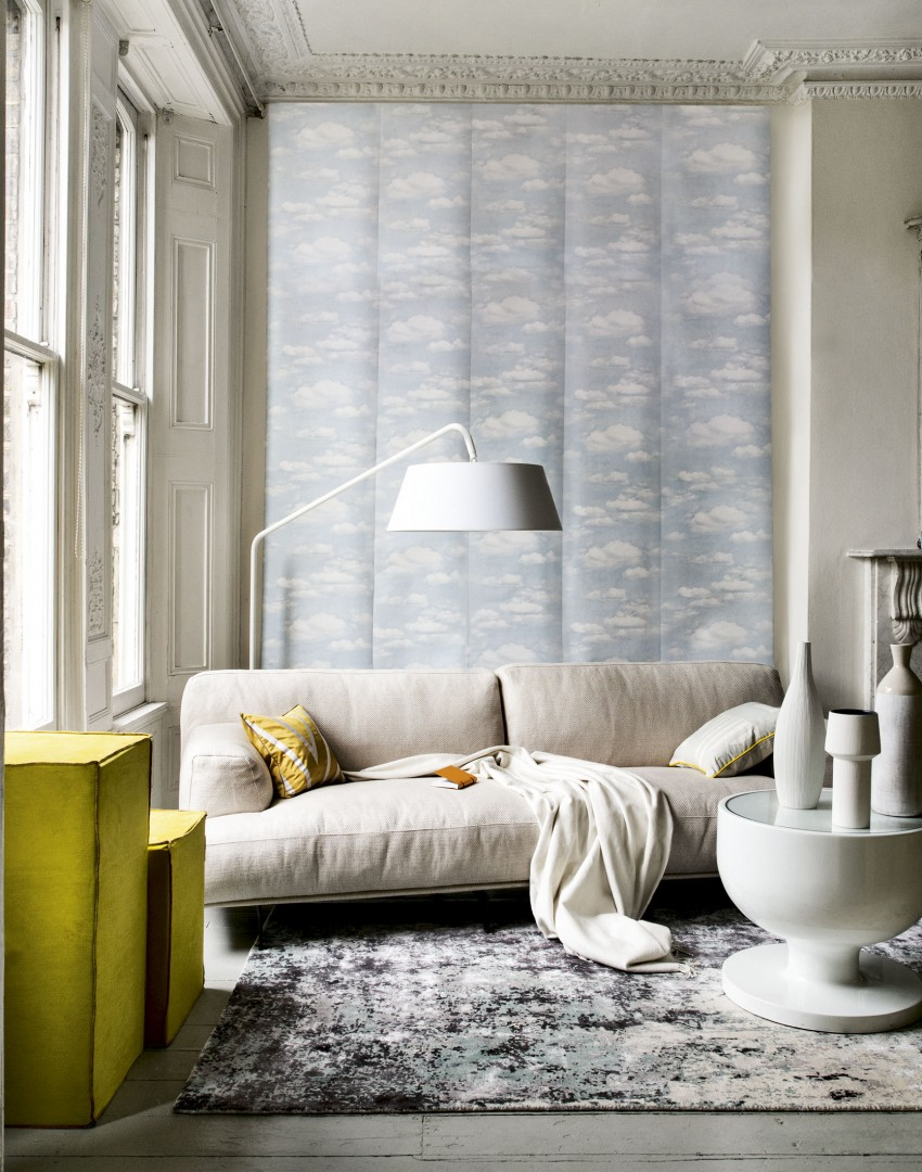 Neutral modern living room with reading lamp and wall mural